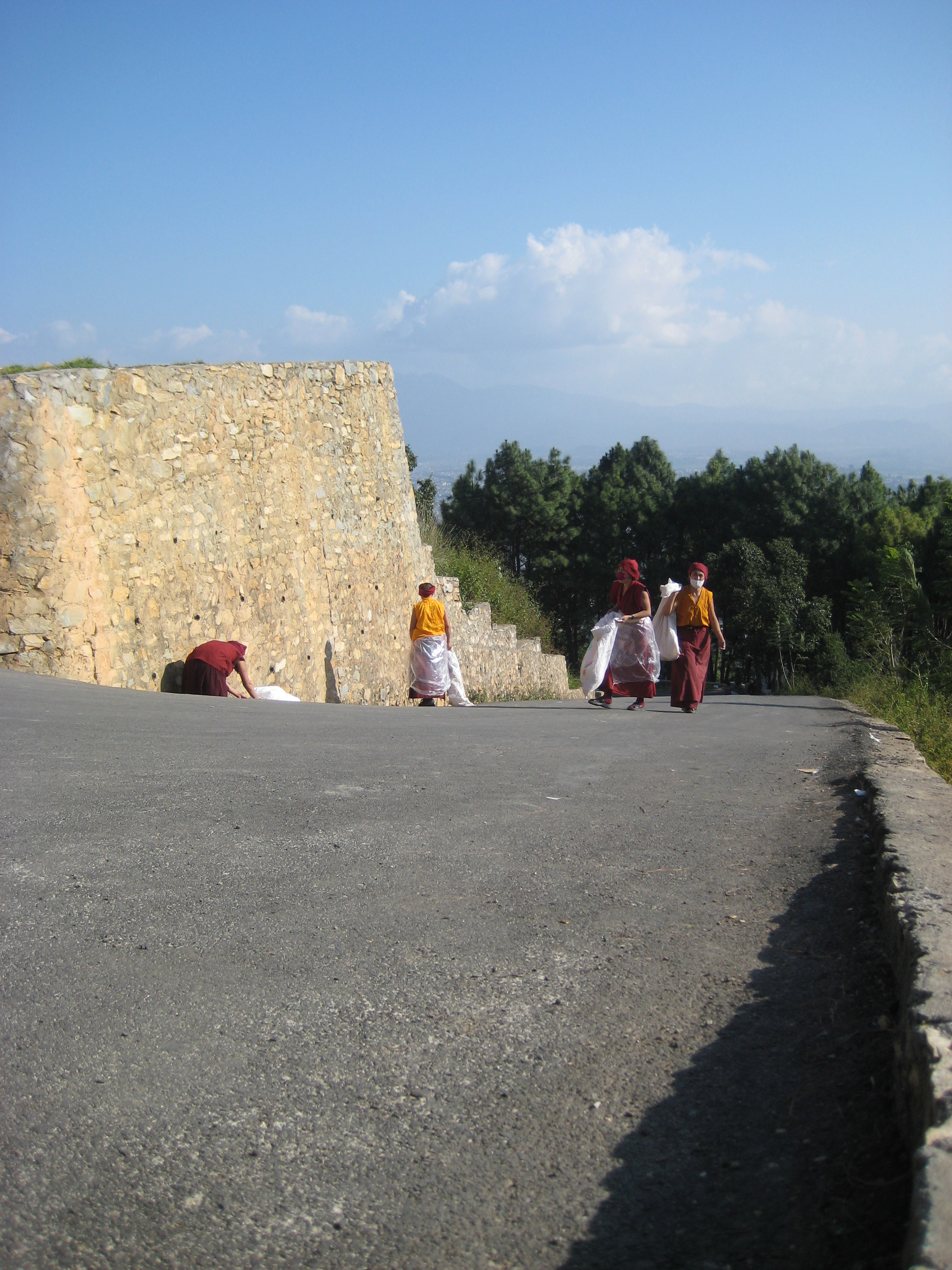 Monks Cleaning the Gumba Area