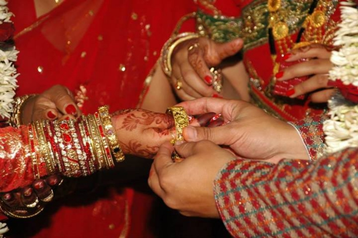 Subash Maharjan Putting Bangel on Shilpa Suwal's Hand during Wedding
